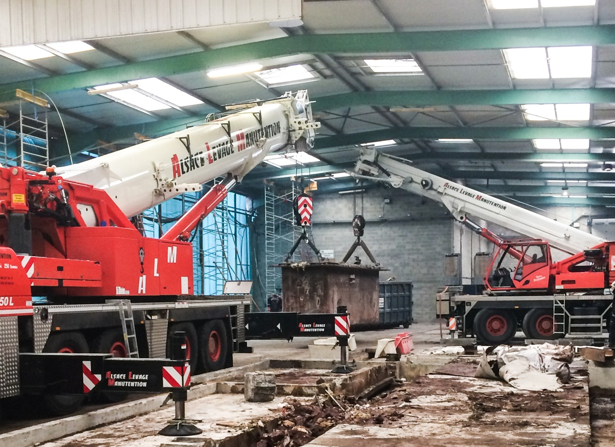 Alsace Levage Manutention (ALM) used two of its Grove all-terrain cranes to complete a technical indoor tandem lift that required unique crane configurations and load charts.
