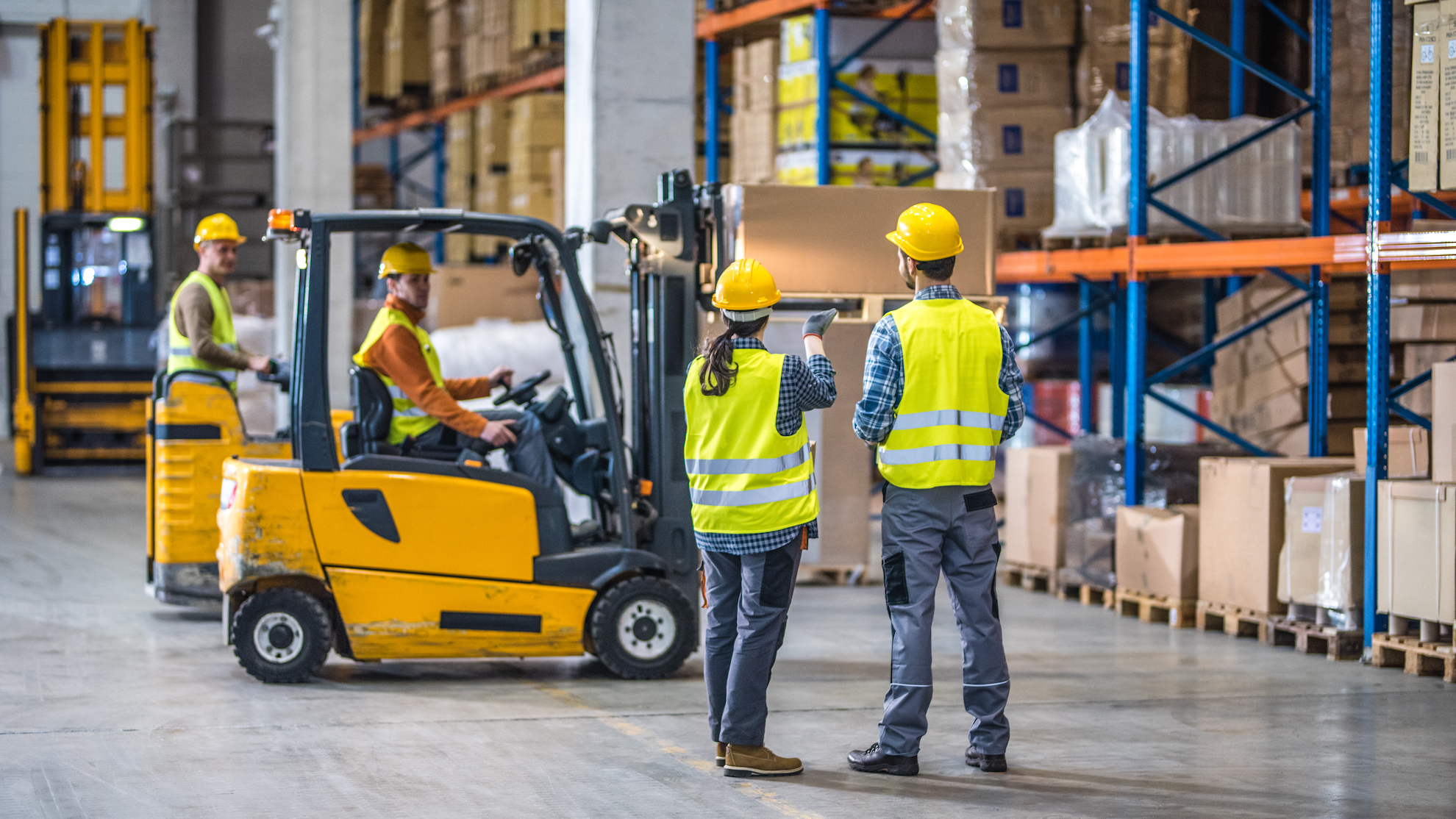Male and female worker working in warehouse.